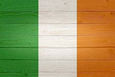 Ireland flag painted on old wood plank background. Brushed natural light knotted wooden planks board texture. Wooden texture background flag of Ireland Banque d'images
