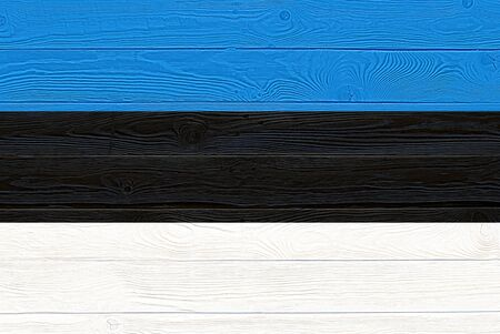 Estonia flag painted on old wood plank background. Brushed natural light knotted wooden planks board texture. Wooden texture background flag of Estonia