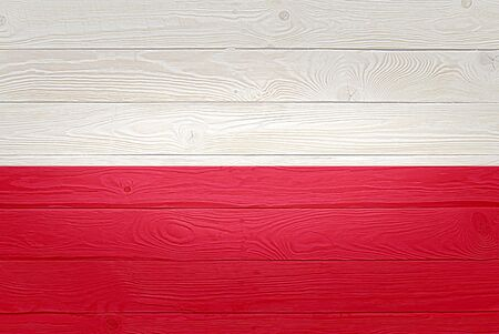 Poland flag painted on old wood plank background. Brushed natural light knotted wooden planks board texture. Wooden texture background flag of Poland
