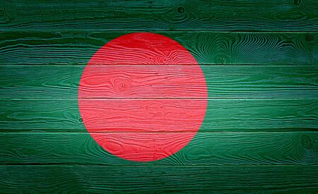 Bangladesh flag painted on old wood plank background. Brushed natural knotted wooden board texture. Wooden texture background flag of Bangladesh.