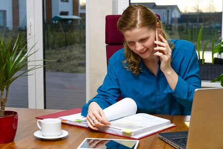 Beautiful young woman working from home, bookkeeper, call center. distance learning, distance working, Home office