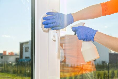 Spring washing of a dirty window. service for washing windows in Domestic homes. a woman in blue gloves provides a window cleaning service. Cleaning service concept