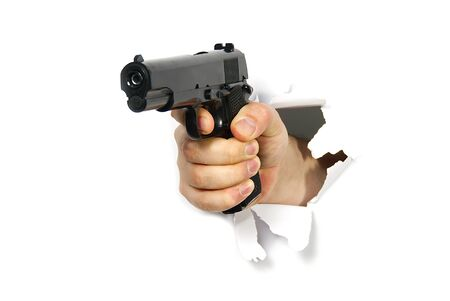 Mens hand with a gun. Crime concept. mans hand holding a black pistol gun, isolated on white, close-up, mockup for layout. Mans hand holding a black gun, aiming. Violence with weapons. Street gangs. Hostilities. Robberies and murders. Fear and hate.