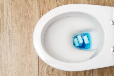 do not throw foreign objects, sanitary pads, tampons, paper, plastic into the toilet. Close-up of a toilet bowl clogged