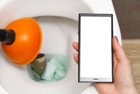 cleaning service concept, woman searching for help in smartphone. mockup. do not throw foreign objects, sanitary pads, tampons, paper, plastic into the toilet. Close-up of a toilet bowl clogged