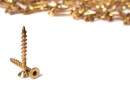 Torx screws close up. Gold screws for wood, chipboard or plywood with torx head.