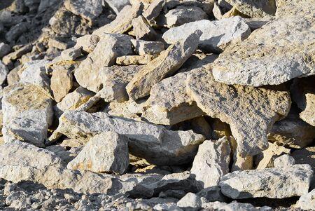 Stack of limestone. big crushed limestone stone. broken sandstone close-up
