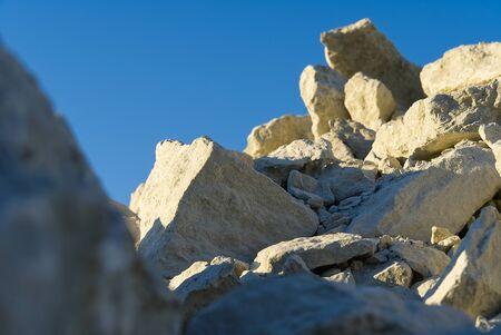 Stack of limestone. big crushed limestone stone. broken sandstone close-up. selective focus. Reklamní fotografie