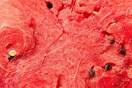 Juicy, ripe, sweet watermelon.. Abstract red fresh watermelon detailed background texture. Archivio Fotografico