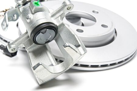 brand new brake caliper and brake discs set for car. isolated on white. Stock Photo