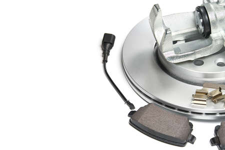 brand new brake discs, brake caliper and brake pad set for car. isolated on white with copy space.