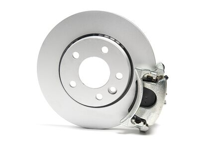 brand new brake discs, brake caliper and brake pad set for car. isolated on white with copy space