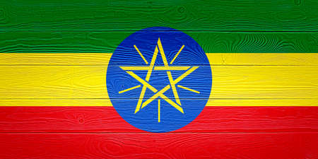 Ethiopia flag painted on old wood plank background. Brushed wooden board texture. Wooden texture background flag of Ethiopia.
