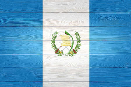 Guatemala flag painted on old wood plank background. Brushed wooden board texture. Wooden texture background flag of Guatemala.