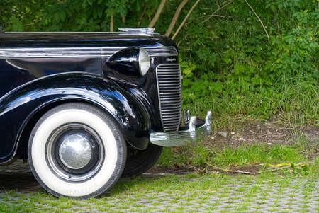 Haapsalu, Estonia - 12.07.2020 : Retro cars In Haapsalu. Closeup of black retro car Chrysler Royal