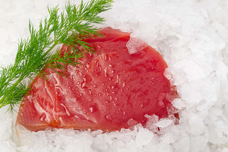 Frozen Tuna steak vacuum with ice on the counter the fishmarket. healfy food and nutrition concept Фото со стока