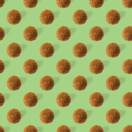 coconut Seamless pattern. Tropical abstract background with isolated Coconut on green background. flat lay.