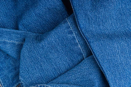 brand new blue jeans textile. jeans macro texture background. Фото со стока