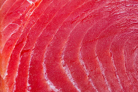 sliced bluefin tuna raw meat texture, close-up Фото со стока
