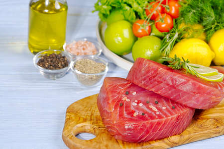 Tuna raw Steak, tuna sashimi, tuna fish sliced with vegetables. healthy eating with seafood, we cook at home