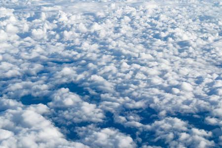 View of the sky above the clouds. blue sky high view from airplane window clouds shapes. sky-clouds background. Above the cloud