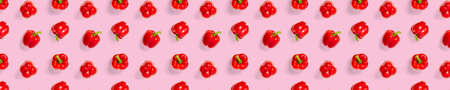 Bulgarian red ripe pepper on pink backdrop. background from paprika, flat lay not seamless pattern