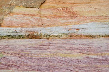 The texture of the layers of sandy rocks. Layers of sand deposits, Devonian horizons. Soil structure allow Sand swallow. The soil layers in the canyon are different colors. The sandy - clay slope collapsed. pressed sand texture