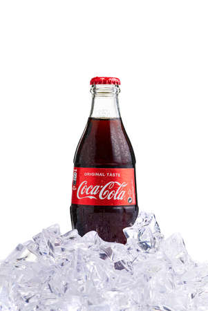 Tallinn, Estonia - 12.02.21 . A bottle of Coca Cola soft drinks. Isolated on white cocacola bottle.