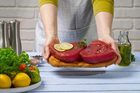 Fresh raw tuna fish was cut into pieces. Cooking Tuna fish at home. sea fish diet