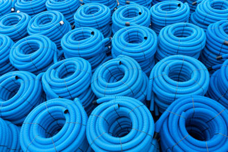 Blue rolls of drainage pipes