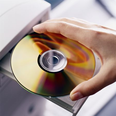 hand insert DVD disk in computer DVD-ROM Stock Photo - 3087455
