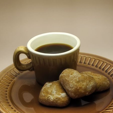coffeebreak: Cup of coffee and three spice-cakes on a ceramic plate