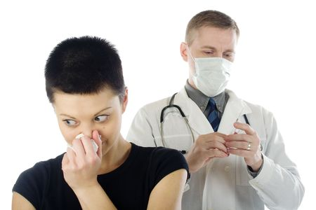 contagion: Surprised woman turns away from a doctor with a syringe. Stock Photo