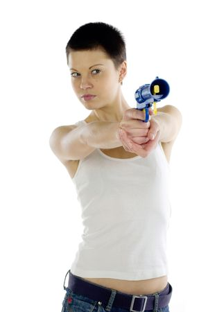 A tank top girl with dark short hair holds a plastic toy pistol photo