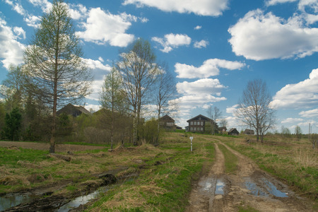 Arkhangelsk village. Old country road to wooden houses