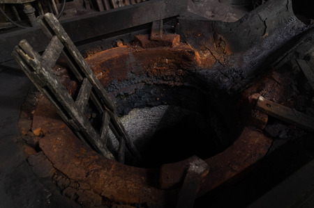 foundry: Cold furnace of abandoned foundry