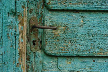 turqoise: Door handle on old painted wooden door Stock Photo