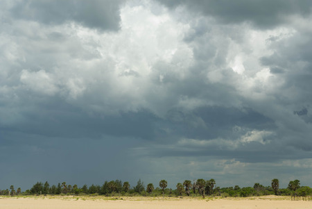 storm clouds: Storm clouds over a flat tropical landscape Stock Photo