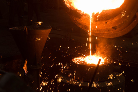 mould: Hot liquid metal pouring into a mould
