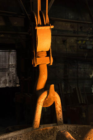 foundry: Closeup of a massive metal hook in a foundry