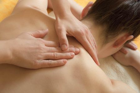 shoulders: Back, neck and shoulder massage performed on a female