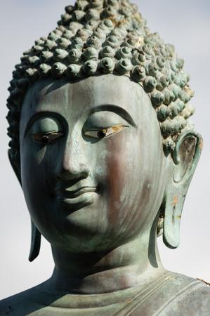 buddha sri lanka: Closeup of bronze Buddha statue, Gangaramaya temple, Sri Lanka Stock Photo