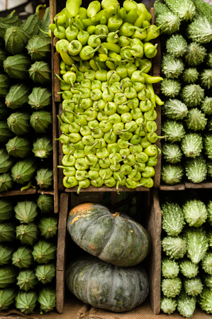 several: Several varieties of tropical vegetables neatly arranged for sale