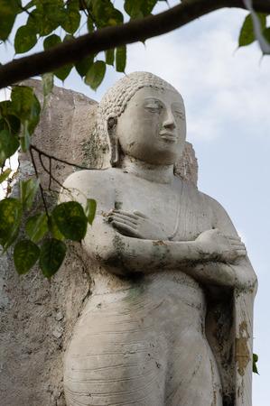 carved stone: Carved stone Buddha statue at Gangaramaya temple, Sri Lanka Stock Photo