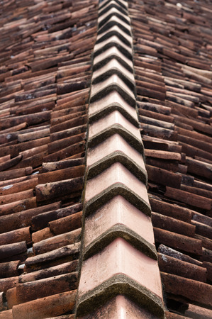 roof ridge: Closeup of roof ridge and broken clay roof tiles