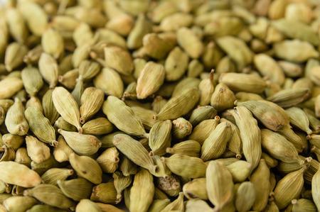 cardamum: Closeup of a heap of dry green cardamons