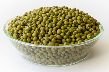 moong: Mung beans in a glass bowl on a white background Stock Photo