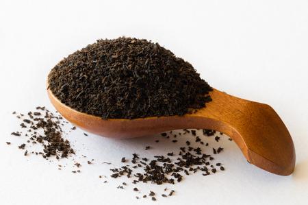ceylon: Small wooden spoon with Ceylon BOP tea on white background