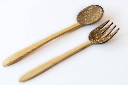 wooden handmade: Coconut shell and wooden handmade fork and spoon on white background