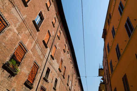 Narrow street with colourful facades and wooden window shutters Stock Photo